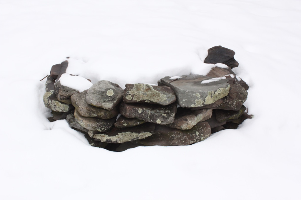 © J.N. Urbanski 1pm Firepit buried under snow.